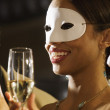 Close up of African woman at masquerade party — Stock Photo