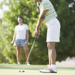 Stock Photo: Africwomplaying golf