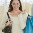Hispanic woman holding shopping bags — Stock Photo