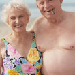 Foto Stock: Senior couple wearing bathing suits