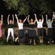 Group of Hispanic women jumping — Stock Photo