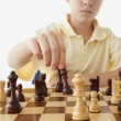 Young boy playing chess — Stock Photo
