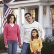 Portrait of family in front yard — Stock Photo #13224991