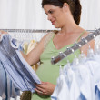 Pregnant Woman Shopping for Baby Clothes — Stock Photo #13224997