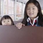 Portrait of girls on school bus — Stock Photo