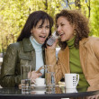 Hispanic women talking on cell phone — Stock Photo