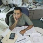Portrait of businessman at desk — Stock Photo