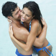 South American couple hugging - Foto Stock