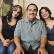Royalty-Free Stock Photo: Portrait of Hispanic family on sofa