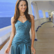 Stock Photo: Hispanic womin evening gown on ship