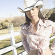 Young woman wearing a cowboy hat - Foto de Stock