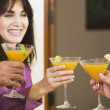 Middle-aged Hispanic woman toasting with friends — Stock Photo