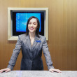 Stock Photo: Businesswomstanding behind desk
