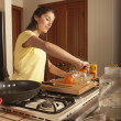 Woman making breakfast — Stock Photo