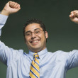Hispanic businessman cheering — Stock Photo #13225294