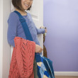 Asian girl carrying book bag in doorway — Stock Photo