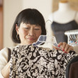 Senior Asian woman shopping for clothing — Stock Photo