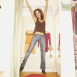 Stock Photo: Womjumping in fitting room