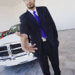 Royalty-Free Stock Photo: Hispanic car salesman extending handshake
