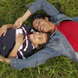 Mother and son relaxing in the grass — Stock Photo