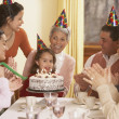 Stock Photo: Family birthday party for Hispanic girl