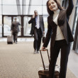 Businesswoman waving from airport terminal — Stock Photo