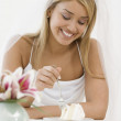 Stock Photo: Hispanic bride eating cake