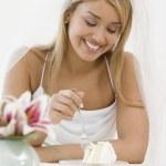 Hispanic bride eating cake — Stock Photo