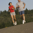 Royalty-Free Stock Photo: Senior couple jogging together