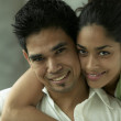 Stock Photo: Portrait of couple hugging