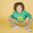 Stok fotoğraf: Portrait of young boy crouching