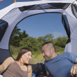 Stock Photo: Couple in tent looking at each other