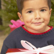 Hispanic boy with Christmas gift — Stock Photo