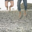 Couple jumping for joy on beach — Stock Photo #13225630