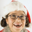 Young girl wearing a Santa hat — Stok fotoğraf
