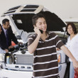 Hispanic family at car dealership - Stock Photo