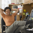 Stock Photo: Businesswoman relaxing at her desk