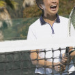 Senior Asian woman on tennis court — Stock Photo