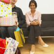 Stock Photo: Young mcarrying girlfriend's presents