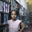 Portrait of girl at library — Stock Photo #13225774