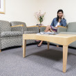 Stock Photo: Womsitting in waiting room