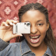 Stock Photo: Portrait of teenage girl taking photograph