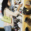 Stock Photo: Hispanic woman at shoe store