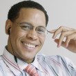 African American businessman with cell phone headset — Stock Photo