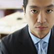 Stock Photo: Close up of Asibusinessman