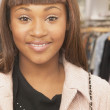 Close up of African American woman smiling — Stock Photo #13225907