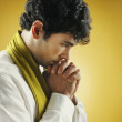 Profile of young man praying - Stock Photo