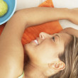 Close up of young woman lying down - Stock Photo