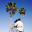 Hispanic couple looking at palm trees — Stock Photo