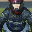 Young woman driving a motorcycle — Stock Photo